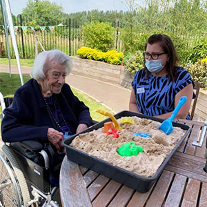 Residents at Lakeview Lodge Care Home enjoy a tropical beach day